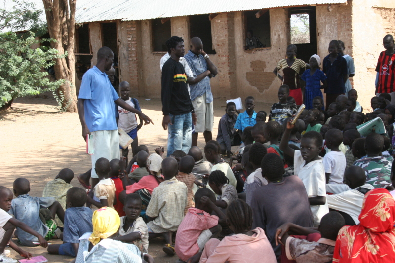 Emmanuel speaks to kids in Kakuma