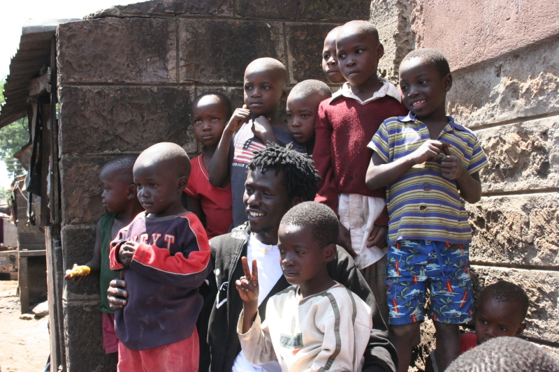Emmanuel with Kids in Nairobi slums